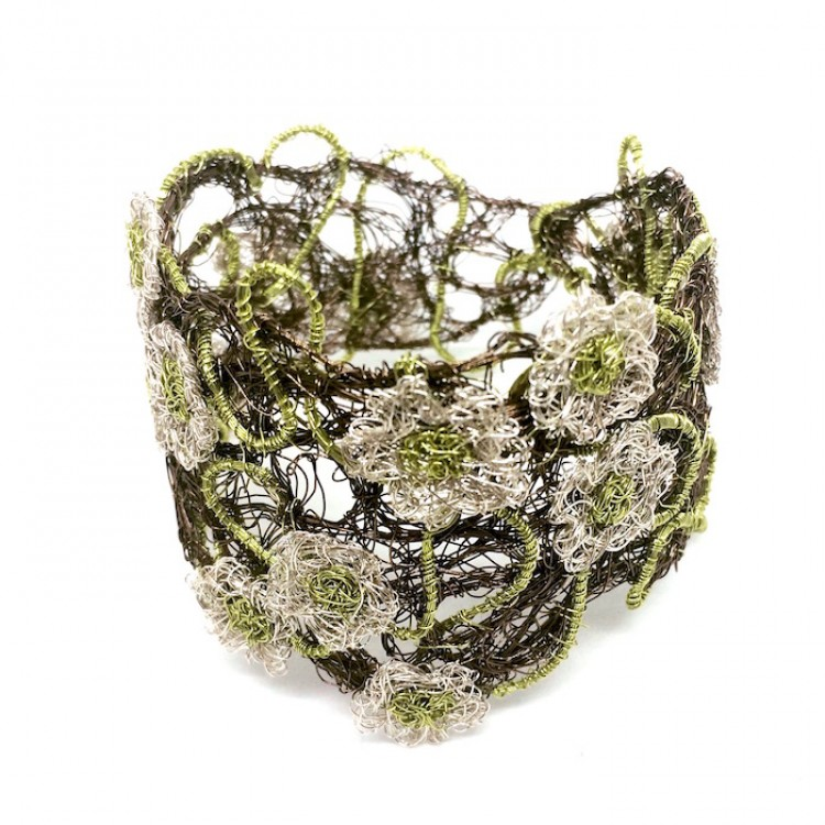 Gunmetal coloured woven wire cuff bracelet with silver and lime flowers