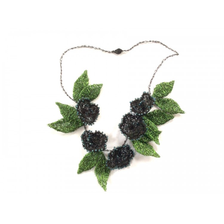 Woven wire black flower necklace with green leaves