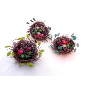 Woven wire bird nest with wire eggs