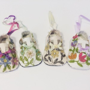 Machine embroidered silk miniature baby shoes
