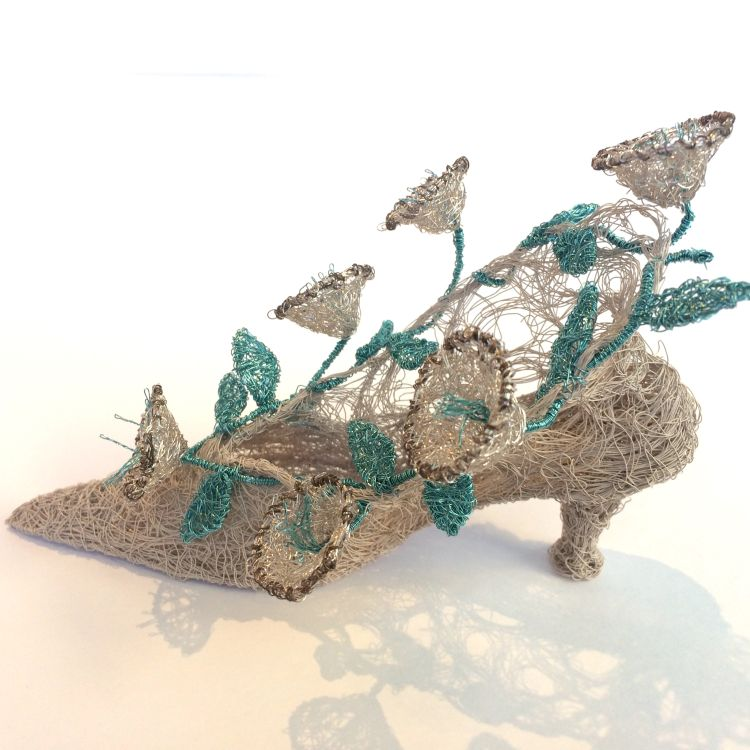 Woven wire vintage style shoe with interwoven flowers
